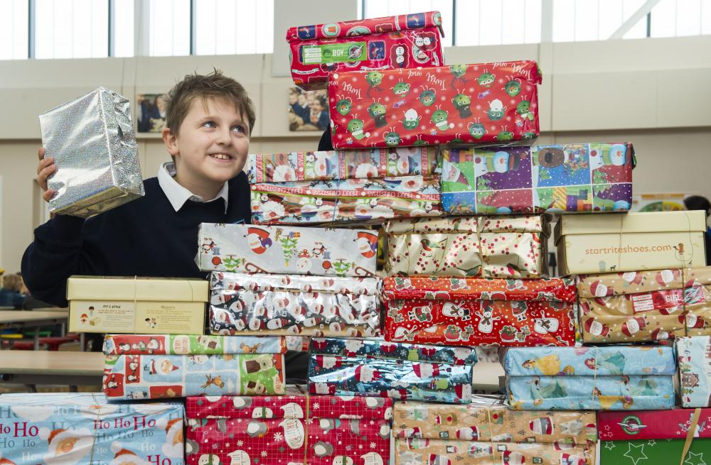 pupils fill 170 shoeboxes with gifts for less fortunate children